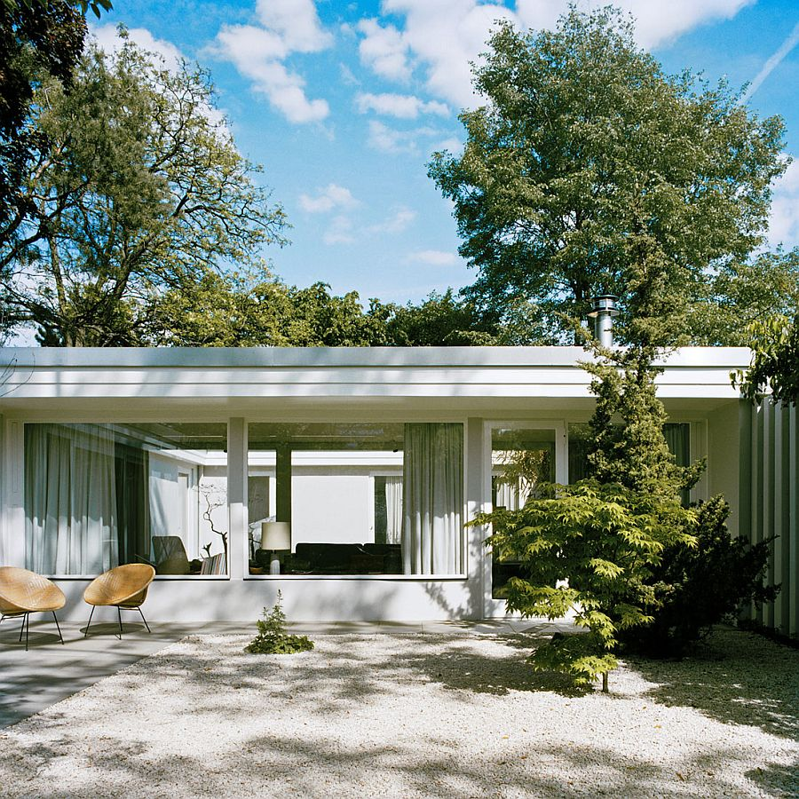 Revamped 1950s Berline home with large glass windows and sweeping courtyards