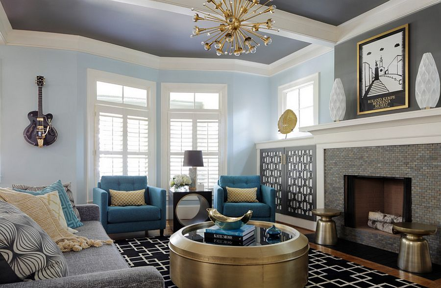 Round metallic coffee table, side tables and chandelier bring glitter to the casual living room [Design: Minhnuyet Hardy Interiors]