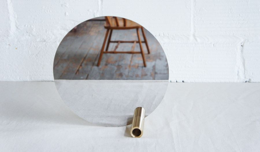 Round mirror with a brass tube