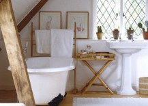 Rustic attic bathroom with wooden beams 217x155 15 Attics Turned into Breathtaking Bathrooms