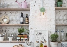Rustic-eclectic-kitchen-with-a-white-brick-wall-217x155