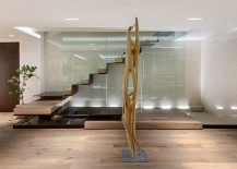 Sculptural-floating-staircase-above-pool-of-water-in-the-living-area-217x155