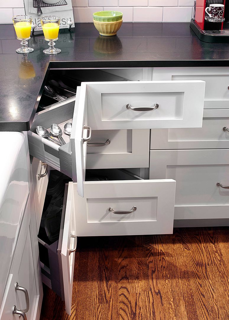 Shaker Style Kitchen With An L Shaped Layout Maximizes Storage Space Corner Pullout Drawers