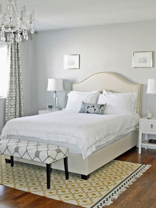 Simple yellow and white rug to brighten up a bedroom