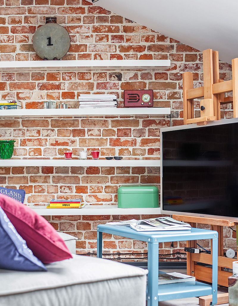 Sleek floating shelves and TV stand for the tiny living room with brick walls