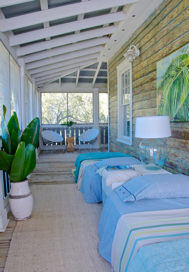 Sleeping porch with bright bedding