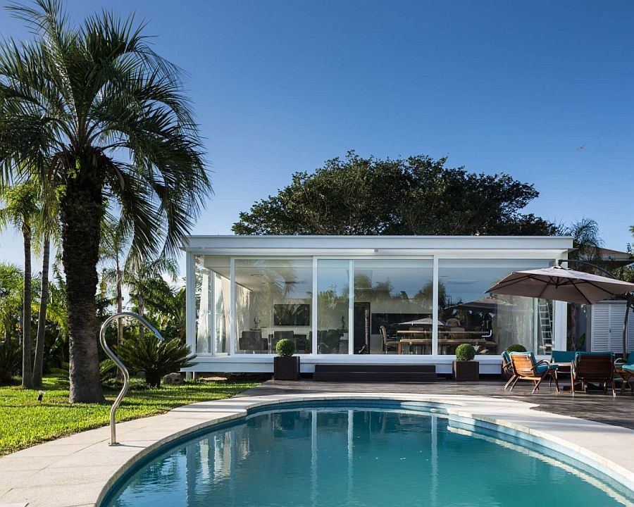 Sliding glass walls of the Pool House bring the outdoors inside