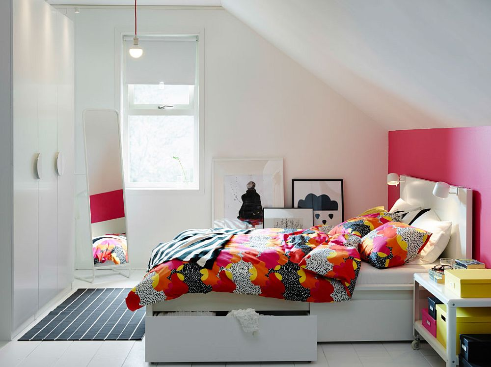 Small IKEA Bedroom idea with bed and storage boxes along with colorful bedding