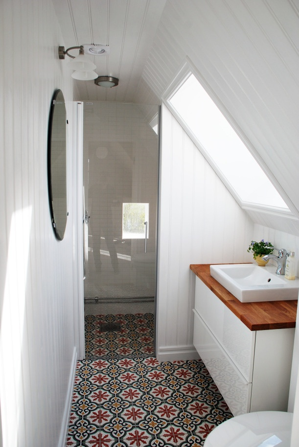 View in gallery Small attic bathroom with Moroccan floor tiles. 15 Attics Turned into Breathtaking Bathrooms