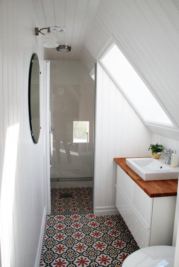 Small attic bathroom with Moroccan floor tiles