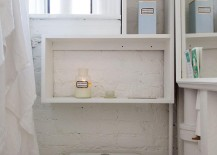 Small-bright-and-airy-bathroom-with-a-painted-brick-wall-217x155
