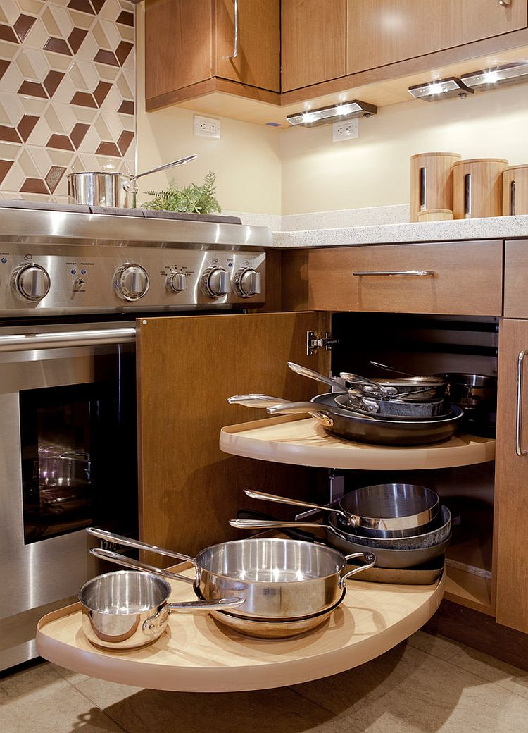 Small contemporary kitchen features corner cabinet with Lazy Susan [Design: KB Cabinets]
