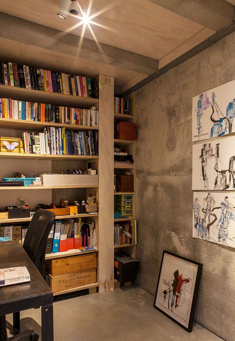 Small home office design with concrete walls