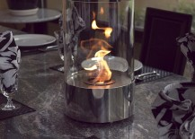 Small portable fireplace in modern glass cylinder 217x155 12 Cozy & Portable Fireplace Ideas for the Modern Home