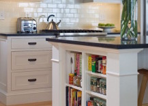 Small shelves built into kitchen island for books and accessories