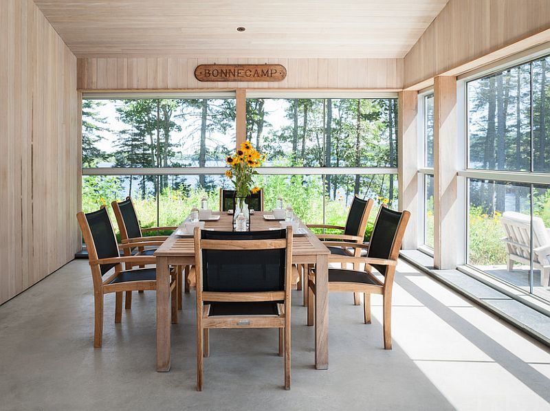 Small sunroom with dining table and chairs [Design: Elliott + Elliott Architecture]
