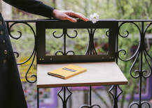 Small table space attached to balcony 217x155 Creative Outdoor Accessories to Hang from Your Balcony Railing