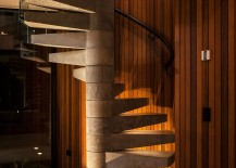 Spiral-concrete-staircase-set-against-a-cedar-clad-wall-217x155