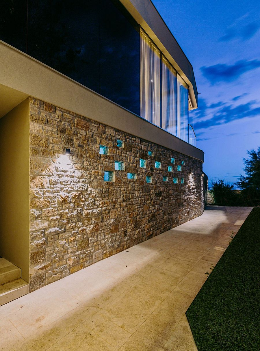 Stone wall around the house defines its entrance