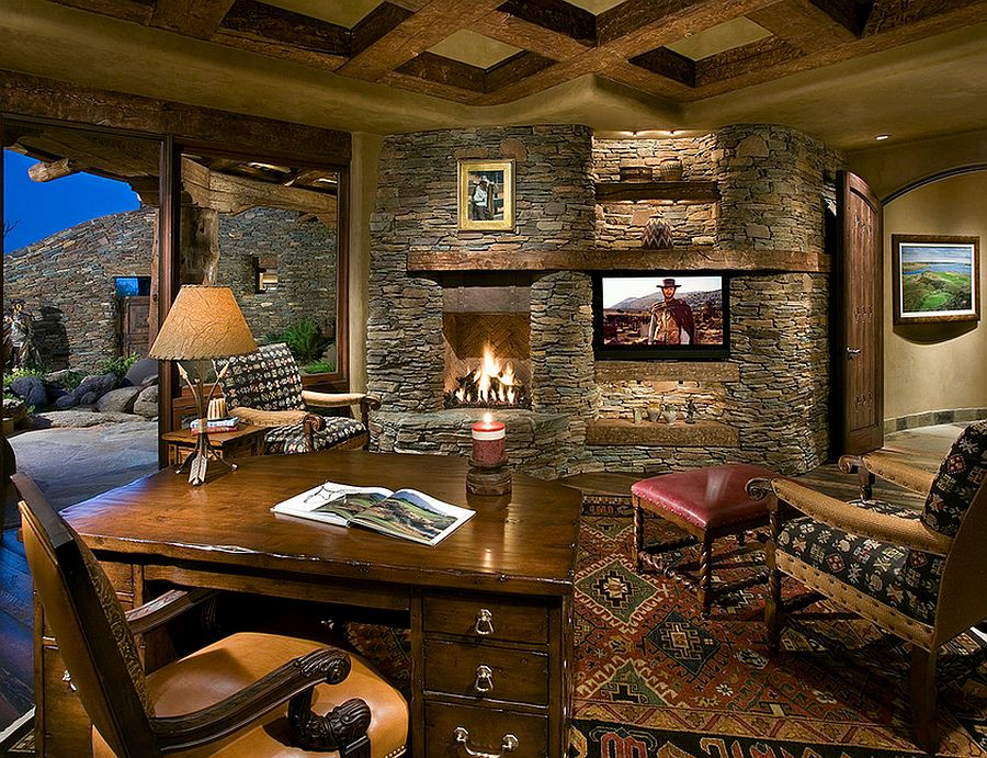 Stone wall with fireplace in the home office [Design: Bess Jones Interiors]