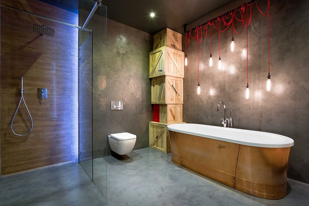 Stripped-down industrial lighting coupled with stunning ambient lighting in the bathroom