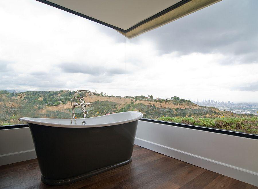 Stunning corner window brings the magic of landscape outside indoors [Design: Janette Mallory Interior Design]