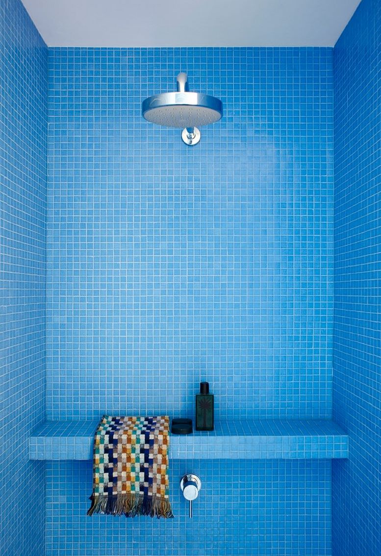 Stunning shower filled with blue tile