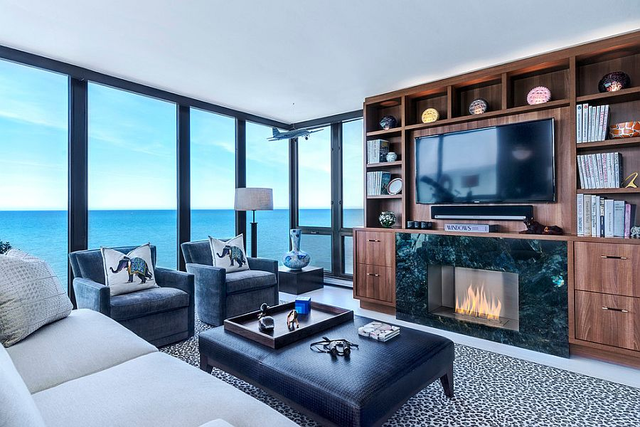 Stunning sunroom with Walnut Entertainment Center and ocean views [Design: NEFF of Chicago Custom Cabinetry and Design Studio]