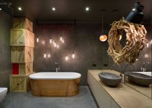 Stunning use of standalone tub and indsutrial style lighting in the bathroom