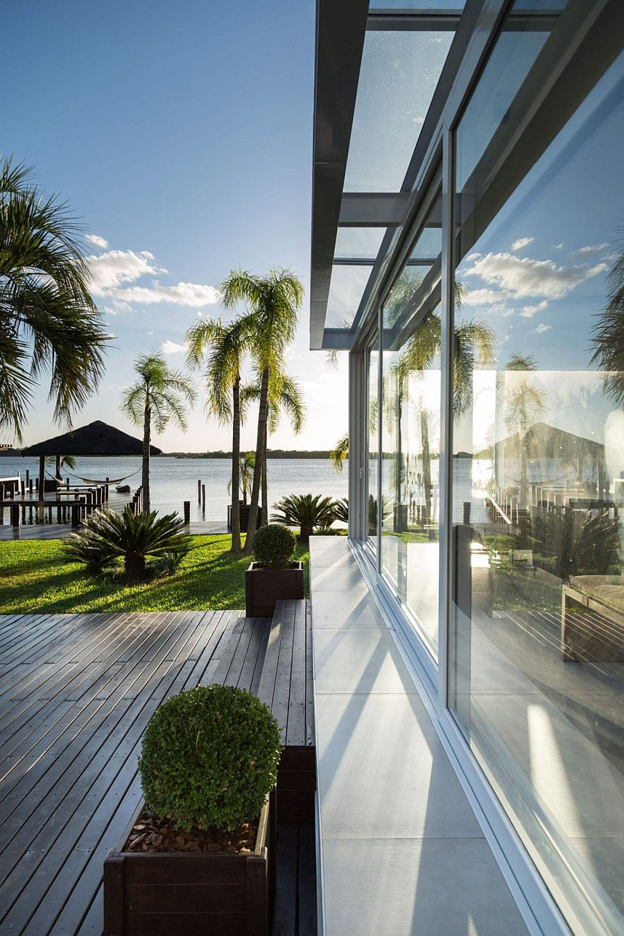 Stunning views of the lake and a relaxing deck grace the lovely pool home