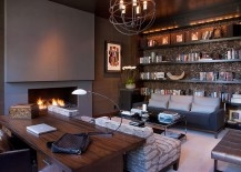 Stylish home office with plenty of shelf space and a chic fireplace