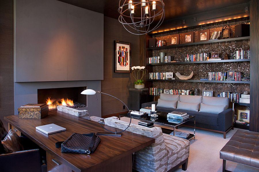 Stylish home office with plenty of shelf space and a chic fireplace [Design: Lori Gentile Interior Design]
