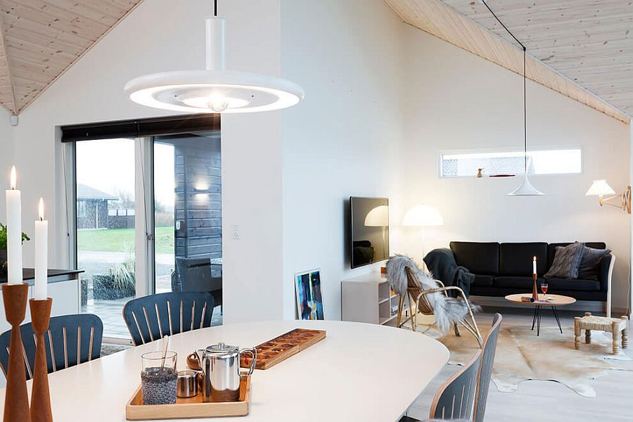 Stylish pendant and sconce lights enliven the relaxing holiday home