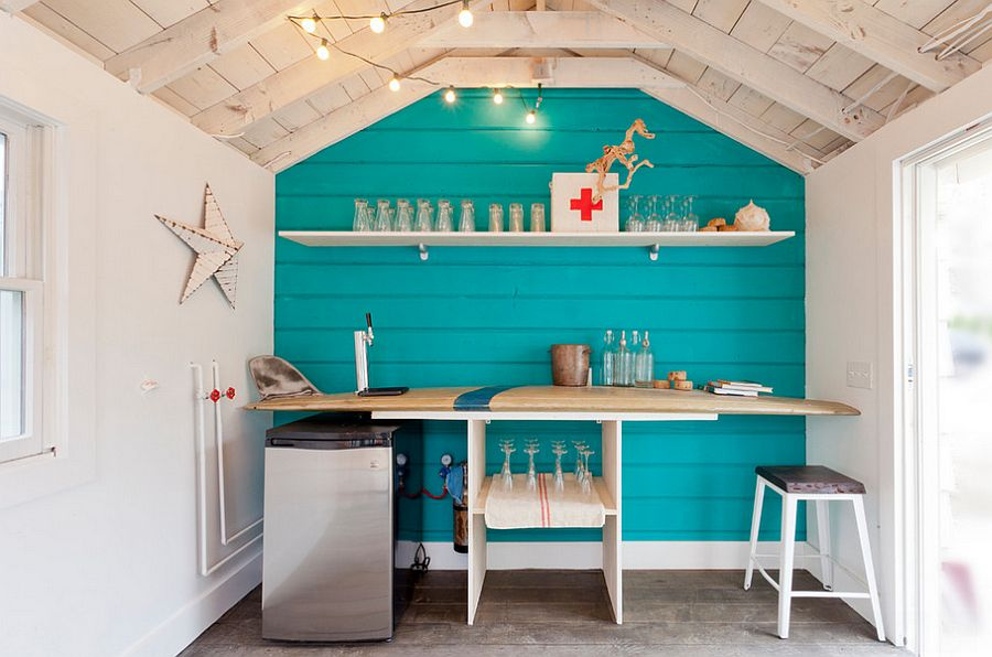 Surfboard bar in the small beach style shed captures the magic of lazy summer days [Design: Brunelleschi Construction]