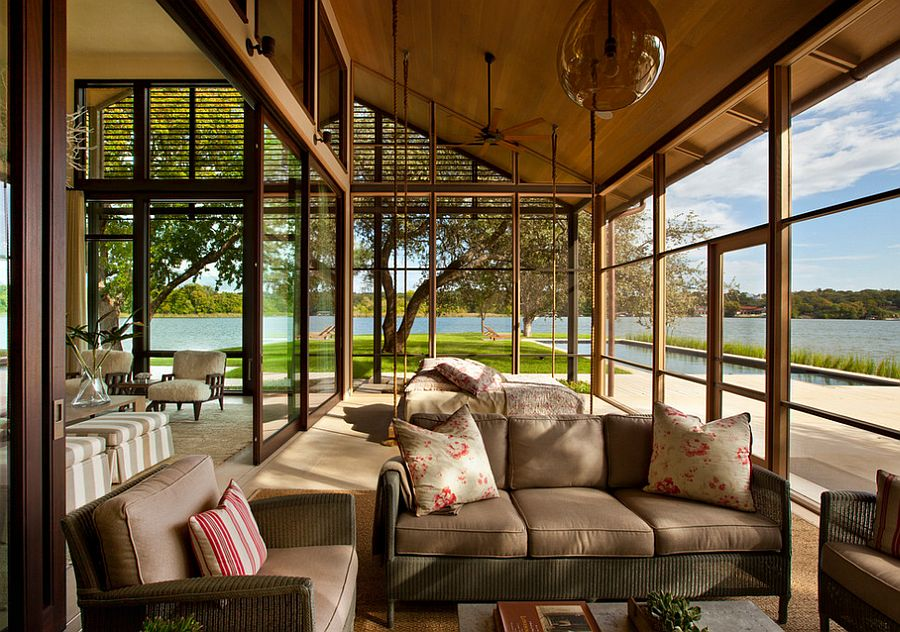 Suspended bed and sliding glass doors for the sunroom with lake views [Design: Furman + Keil Architects]