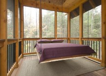 Suspended bed on a screened-in sleeping porch
