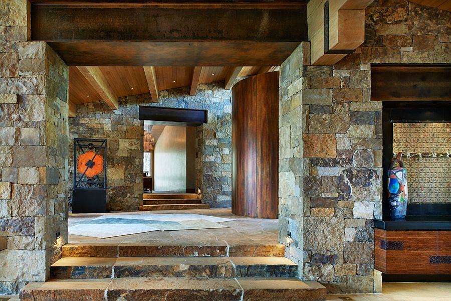 Sweeping entrance of the rustic retreat in stone and wood