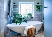 There is no shortage of greenery in this contemporary bathroom with a tropical edge