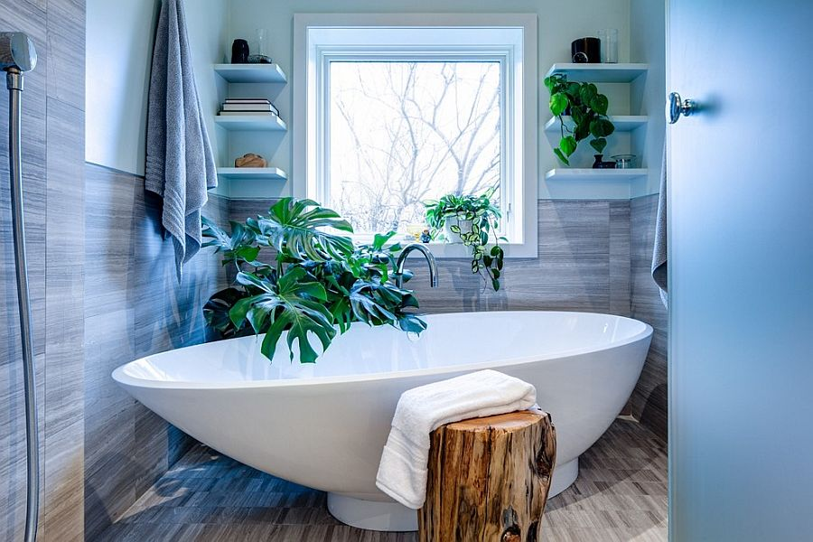 There is no shortage of greenery in this contemporary bathroom with a tropical edge [Design: Beauparlant Design]