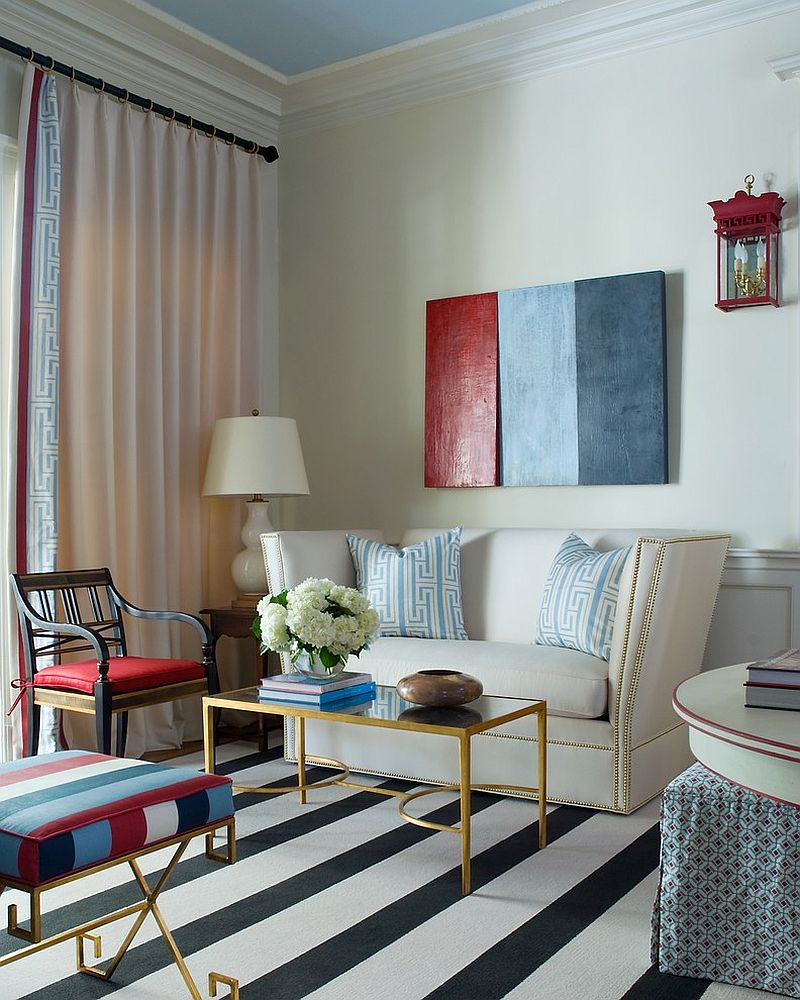 Three piece gold-leaf, mirror top coffee table from Worlds Away [Design: Tobi Fairley Interior Design]