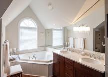 Tiny-bathroom-with-bathtub-next-to-the-window-217x155