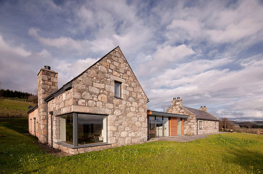 Revitalized cottage in stone and wood captures the aura of for Modern stone houses architecture