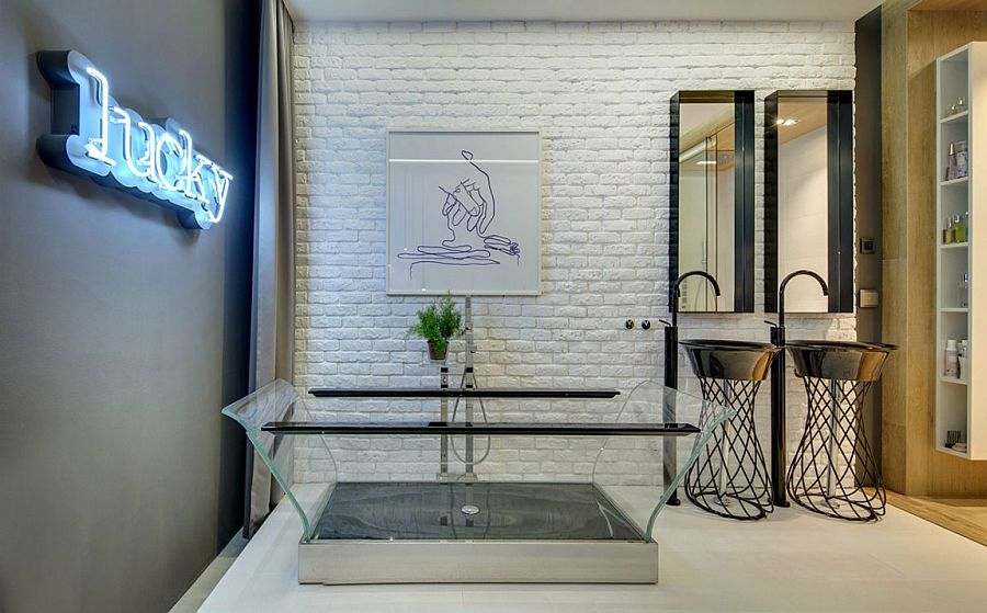 Transparent bathtub and bright neon wall sign for the eclectic contemporary bath