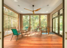 Treehouse sunroom with simple, understated decor [Design: Sagatov Design-Build]