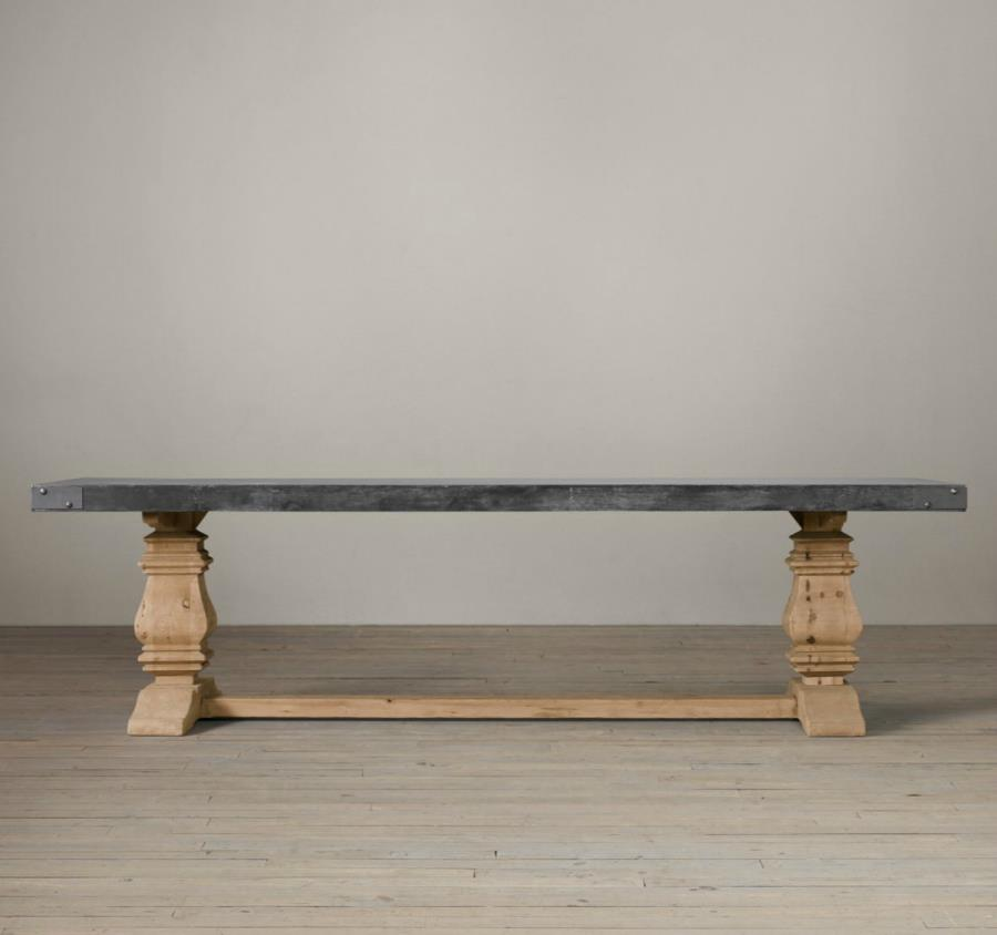 Trestle dining table with a concrete top from Restoration Hardware