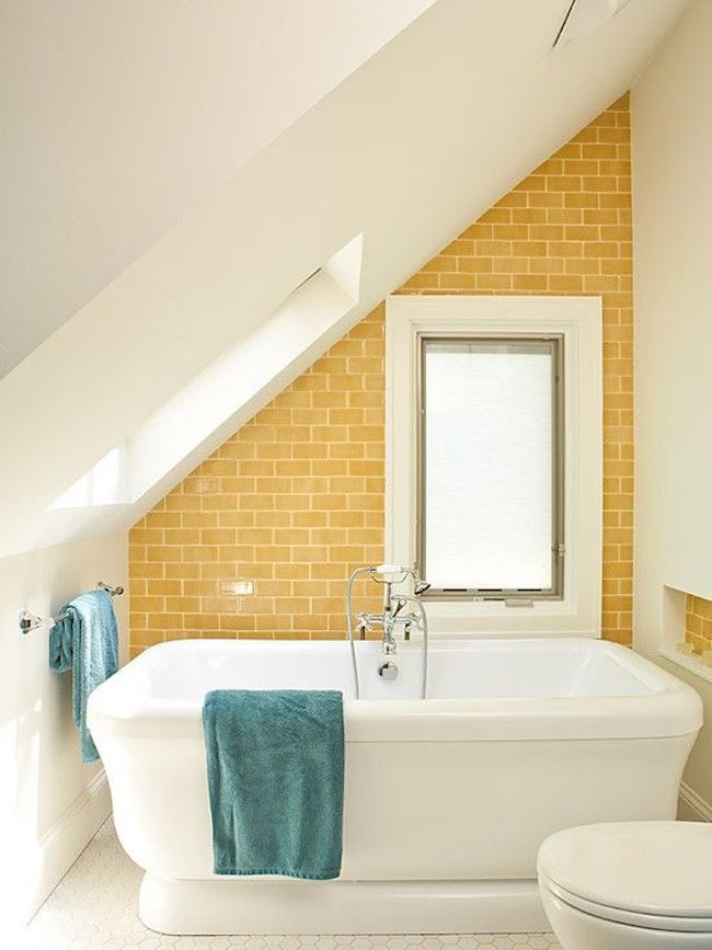 Tub with yellow brick wall in attic