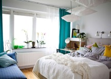 Turn-to-sconces-above-the-headboard-to-get-some-reading-done-in-the-bed-217x155