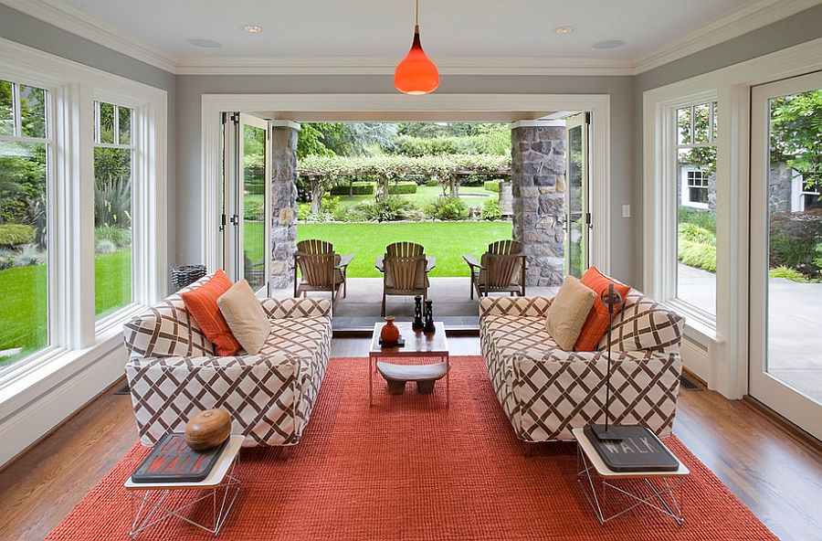 Twin Eames Wire Tables add to the style of the cool sunroom [Design: Emerick Architects]
