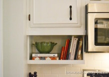 Under the cabinet cookbook holder 217x155 15 Unique Kitchen Ideas for Storing Cookbooks