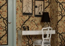 Unexpected touches in a bedroom with cherry blossom wallpaper